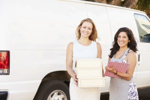 Two Women Running Catering Business With Van